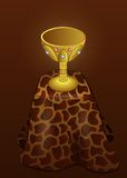 Gold Cup on the leopard fur Royalty Free Stock Images