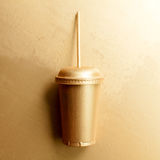 Gold cup straw. On gold background. Fast food art poster for success Royalty Free Stock Photos