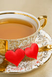 Gold cup tea Royalty Free Stock Photography