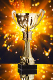 Gold cup trophy against shiny background Royalty Free Stock Photography