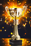 Gold cup trophy against shiny background Royalty Free Stock Image