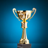 Gold cup trophy on blue Stock Image
