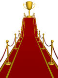 Gold cup of the winner on a red carpet. Gold cup of the winner on a red carpet path Royalty Free Stock Photo