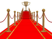 Gold cup of the winner on a red carpet path. 3D image Royalty Free Stock Photo