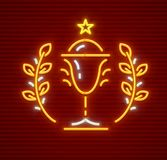 Gold cup for winner in sporting competition. Gold cup for winner in championship sports competition. First place award for champions. Neon icon. EPS10 vector Royalty Free Stock Image
