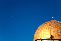 Gold cupola on the background of bright blue sky. Dome of the Rock gold cupola on the background of bright blue sky Stock Images