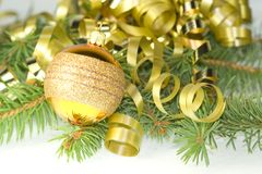 Gold curly ribbon and ball Royalty Free Stock Photography