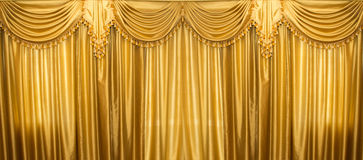 Gold curtains on stage Stock Image
