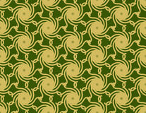 Gold Cyclone on Green Pattern Royalty Free Stock Photo