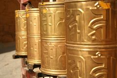 Gold cylinders Stock Images