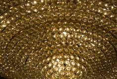 Gold cystal glass ball with warm ligh in chadelier stock photo
