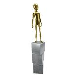 Gold 3d humanoid standing on cubes Stock Photography