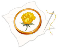 Gold Damask Rose Embroidery. Wooden embroidery hoop with yellow damask rose stitchery, silver needle and thread on a white background Royalty Free Stock Photo