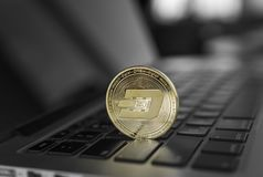 Gold Dash crypto coin on a laptop keyboard. Exchange, bussiness, commercial. Profit from mining crypt currencies. Miner. With ethereum coin royalty free stock photos