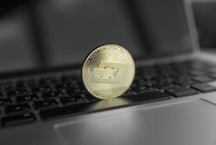 Gold Dash crypto coin on a laptop keyboard. Exchange, bussiness, commercial. Profit from mining crypt currencies. Miner. With ethereum coin stock images