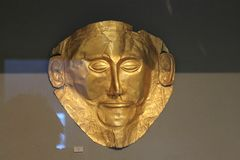 Gold death-mask  in Athens Arheological museum. Gold death-mask  in Athens, known as the `mask of Argamemnon`  This mask depicts the imposing face of a bearded Royalty Free Stock Photos