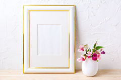 Gold decorated frame mockup with flower bouquet in flowerpot Stock Photo