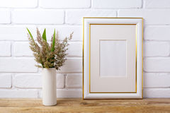 Gold decorated frame mockup with grass and green leaves in cyli stock images