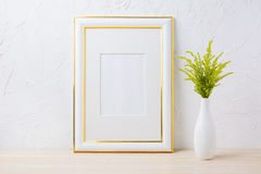 Gold decorated frame mockup with ornamental grass in exquisite v Royalty Free Stock Image