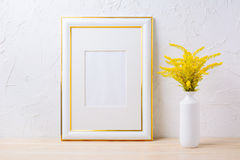 Gold decorated frame mockup with ornamental yellow flowering gra Royalty Free Stock Photography