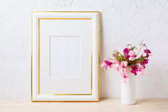 Gold decorated frame mockup with pink and purple flower bouquet stock photos
