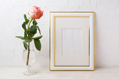 Gold decorated frame mockup with rose in exquisite glass vase Stock Images