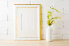 Gold decorated frame mockup with yellow green wild grass ears Royalty Free Stock Photo