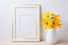 Gold decorated frame mockup with yellow rosinweed flowers Stock Photography