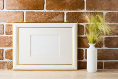 Gold decorated landscape frame mockup with ornamental grass in s Royalty Free Stock Photography