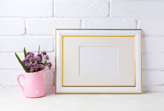 Gold decorated landscape frame mockup with purple flowers in pin royalty free stock image