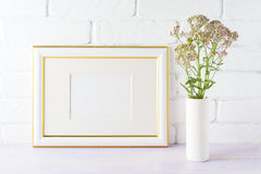 Gold decorated landscape frame mockup with wild creamy pink flow Stock Photography