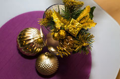 Gold decoration, balls on New Year, Christmas with small gift on Royalty Free Stock Photos
