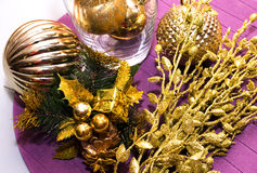 Gold decoration, balls on New Year, Christmas with small gift on Royalty Free Stock Images