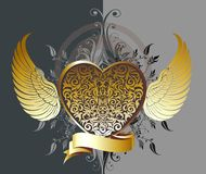 Gold decorative heart with wings Stock Photos