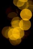 Gold defocused bokeh. Gold color defocused lights circular bokeh abstract background Stock Photo