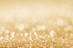 Gold defocused glitter background Royalty Free Stock Photos
