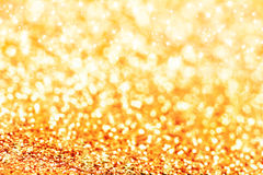 Gold defocused glitter background Stock Photos