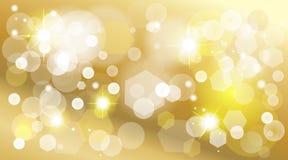 Gold defocused lights effect shine wallpaper. Stars, snowflakes, glitter, golden blurred sparkles, bokeh lights golden background. Christmas, birthday Royalty Free Stock Photo
