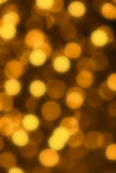 Gold defocused lights useful as a background. Good for website designs or texture Royalty Free Stock Image