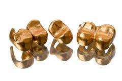 Gold dental crowns Royalty Free Stock Photos