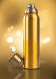 Gold Deodorant Perfume Can or Bottle Bokeh Background Stock Photo