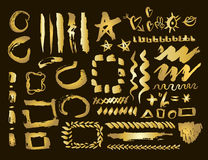 Gold design elements set. Brush strokes and borders.Golden stain set. Vector Illustration. Stock Images