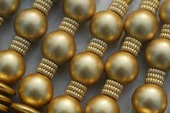 Gold designer jewelry pattern Royalty Free Stock Photo