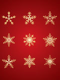 Gold detailed snowflakes Stock Images