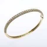 Gold and Diamond Bracelet. Ornate diamond  gold bangle bracelet on white Stock Photography