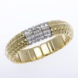 Gold and Diamond Bracelet. Ornate diamond  gold cuff bracelet on white Royalty Free Stock Photos