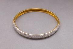 Gold Diamond Bracelet on Gray Background Royalty Free Stock Image