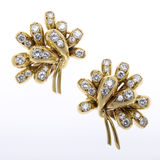 Gold and Diamond Earrings. On white Stock Photos