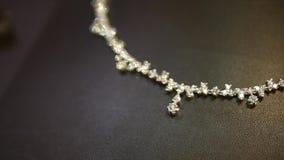 Gold diamond necklace stock footage