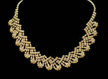 Gold and diamond necklaces isolated on black background. Royalty Free Stock Photo